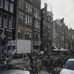 Amsterdam, Netherlands - bicycles, amstel, downtown, tourists Stock Footage
