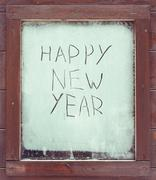 """The inscription """"Happy New Year"""" on the frosty window Stock Illustration"""