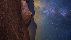 MoCo Pan Astro Timelapse of Milky Way over Native American Petroglyphs -Vertical Stock Footage