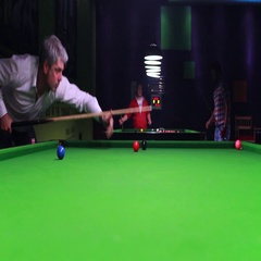 Footage of a young handsome man in a white shirt playing snooker Stock Footage