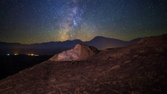 MoCo Pan Astro Timelapse of Milky Way over Native American Petroglyphs -Zoom In- Stock Footage
