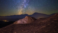 MoCo Pan Astro Timelapse of Milky Way over Native American Petroglyphs -Zoom Out Stock Footage
