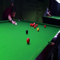A snooker player manages to bring the red ball into the hole Stock Footage