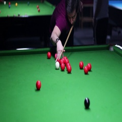 A moving shot showing a young man playing snooker, he hits and makes a point Stock Footage