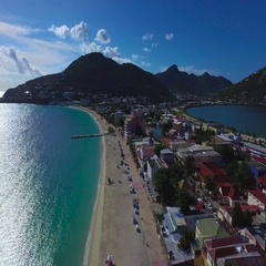 4K aerial flying backwards reveal shot at Great Bay Town, St Maarten, Okt 2016 Stock Footage