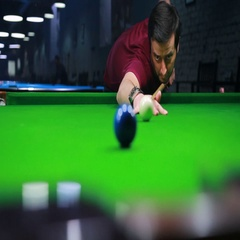 Close up footage above a hole and a snooker player hitting the blue ball Stock Footage