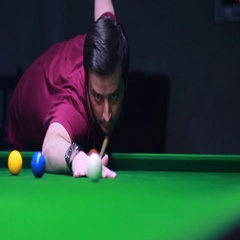 Footage of a snooker player hitting the ball, he misses the hole Stock Footage