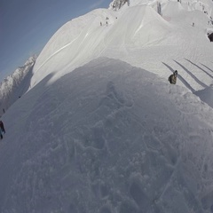Snowboarder jumps trick on big air Stock Footage