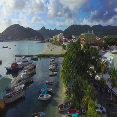 4K aerial reveal shot of fishing harbor at Great Bay Town, St Maarten, Okt 2016 Stock Footage