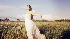 Gorgeous lady feeling air in corn field Stock Footage