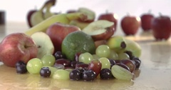 Large hand grabbing a selection of healthy fruit Stock Footage