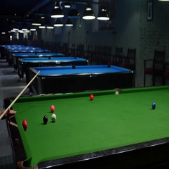 Side shot of a snooker game and a player enjoying in a snooker game Stock Footage