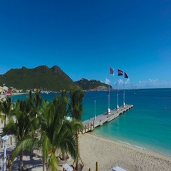 4K aerial of beach, pier and flags at Great Bay Town, St Maarten, Okt 2016 Stock Footage