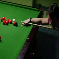 A player playing snooker, the shot goes out of focus after the shot Stock Footage