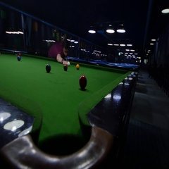 A young man playing snooker in an entertainment center, he makes a point Stock Footage