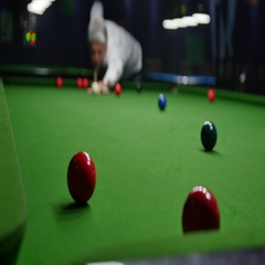 Footage of a man playing snooker, he hits the red ball but misses the hole Stock Footage