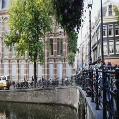 Bridge on canal in Amsterdam, Amstel, Holland, Netherlands Stock Footage