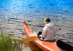 Back of the girl in boat with oar backgorund Stock Photos