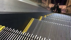 Escalator ride down with view on steps 4k Stock Footage