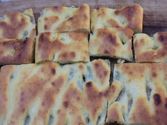 One hand take a piece of Focaccia Stock Footage
