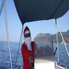 Santa Claus driving a motor boat on the sea Stock Footage