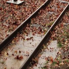 Water floods the railways tracks Stock Footage