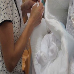 Dress the baby on the hands Stock Footage