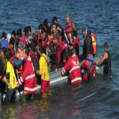 LESVOS, GREECE - NOV 2, 2015: Refugees leave rubber dinghy near the shore Stock Footage