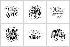 Set of winter black and white handwritten lettering inscription Piirros