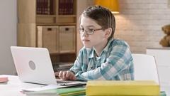 Schoolboy Working on Laptop Stock Footage