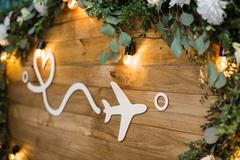 Plane on wooden boards decorated with flowers. distance and lov Stock Photos