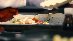 Cook mixes Greek salad on the restaurant's kitchen, hands close-up Stock Footage