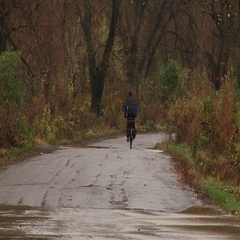 Cyclist rode flooded road Stock Footage
