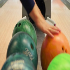 The girl choose bowling balls Stock Footage