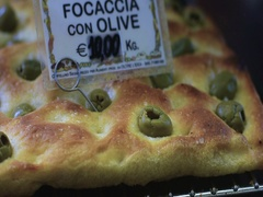 Some pieces of focaccia with olives,  a typical italian bread Stock Footage