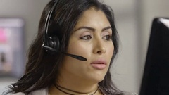 Close up of a young hispanic female customer service representative Arkistovideo
