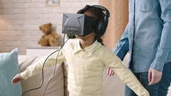 Showing Daughter VR Device Stock Footage