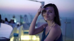 Portrait of young, pretty woman sitting in the bar during night, 4k Stock Footage