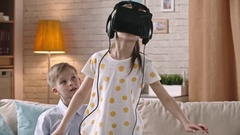 Girl Playing Video Game in VR Glasses Stock Footage