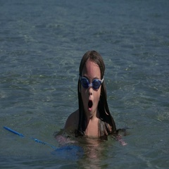 Child playing in the sea, swimming and diving Stock Footage