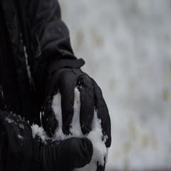 Footage man sculpts hands a snowball outdoors. 4K Stock Footage