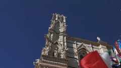 Panoramic shot of Siena Cathedral with Palio flags fluttering, Tuscany, Italy Stock Footage
