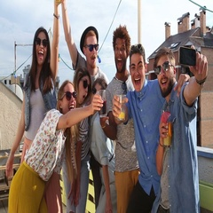 Crazy young friends taking selfie on the rooftop terrace Stock Footage