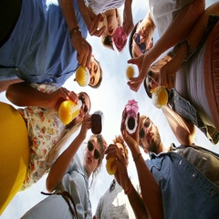 Group of eight happy friends looking down at camera and toasting Stock Footage