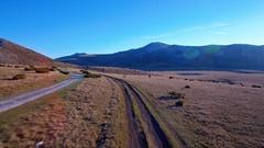 Mountain pastures aerial beautiful landscape valley grass autumn sunlight sky Stock Footage