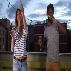 Man and woman waving with firework candles and holding glass of champagne Arkistovideo