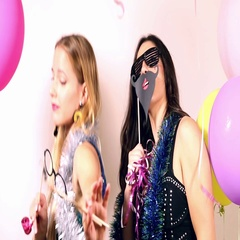 Beautiful women having fun dancing using props in party photo booth Stock Footage