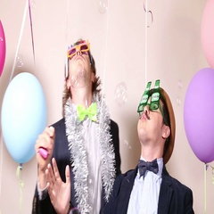 Party guys having fun with funny props in photo booth Stock Footage