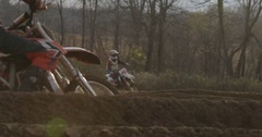 Motocross racing on dirty track two riders and lens flare Stock Footage