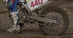 Motocross tire spinning out in dirt track racing Stock Footage
